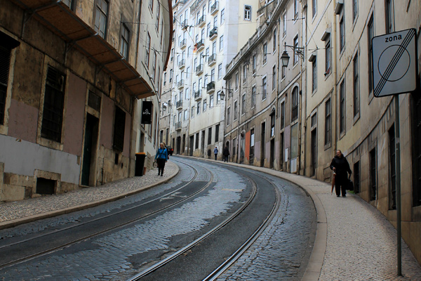 people walking on the slopery slopes of Lisbon, Portugal